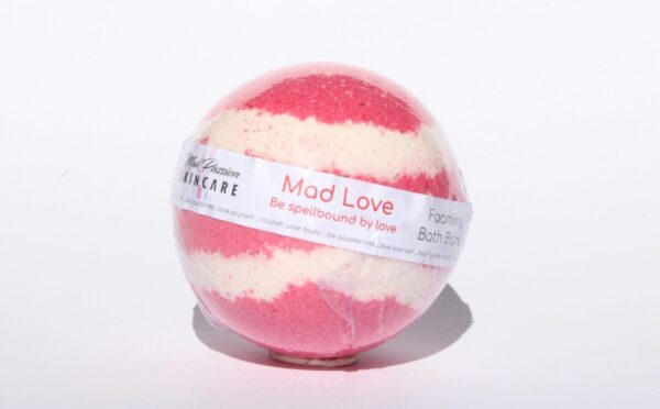 """<span style=""""font-weight: 400;"""">Striking layers of red and white makes the Mad Love Bath Bomb a beautiful addition to your bathtime. This fragrance is a luscious fusion of citrus, cherry blossom, hydrangea, apple and peach, with a touch of light wood.</span>  <span style=""""font-weight: 400;"""">All of our Bath Bombs are hand mixed and hand-formed. No machines.</span>"""